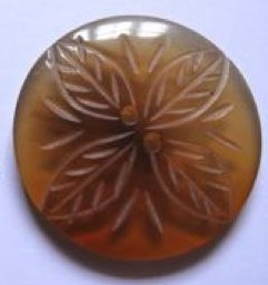 Handcarved opaque flower button